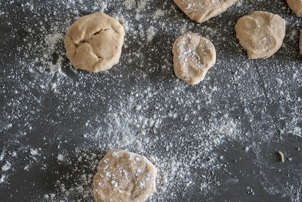 pie dough pieces on floured counter top