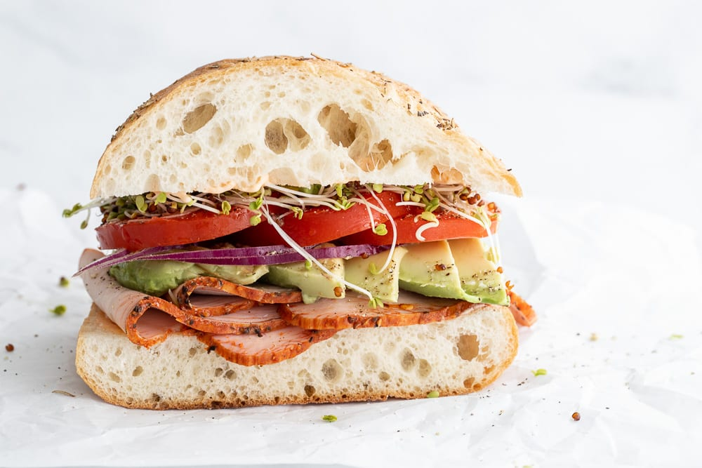 Turkey and sprouts on ciabatta sandwich