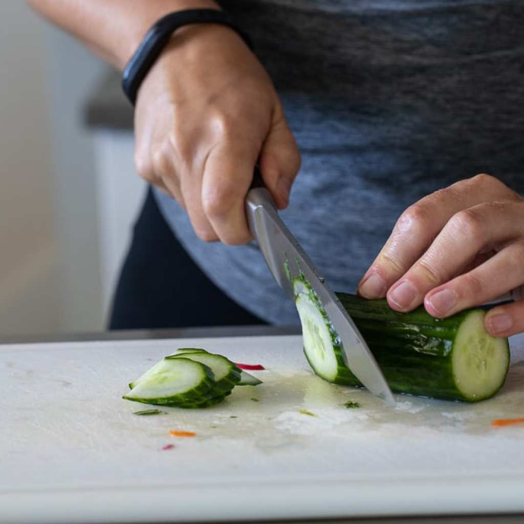 woman slicing cucumbers