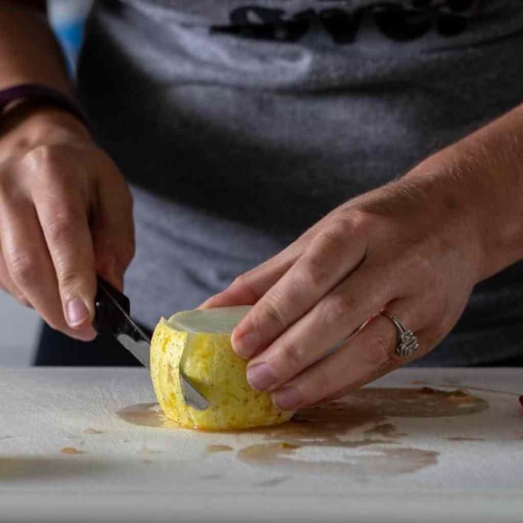 woman peeling a lemon cucumber for slicing