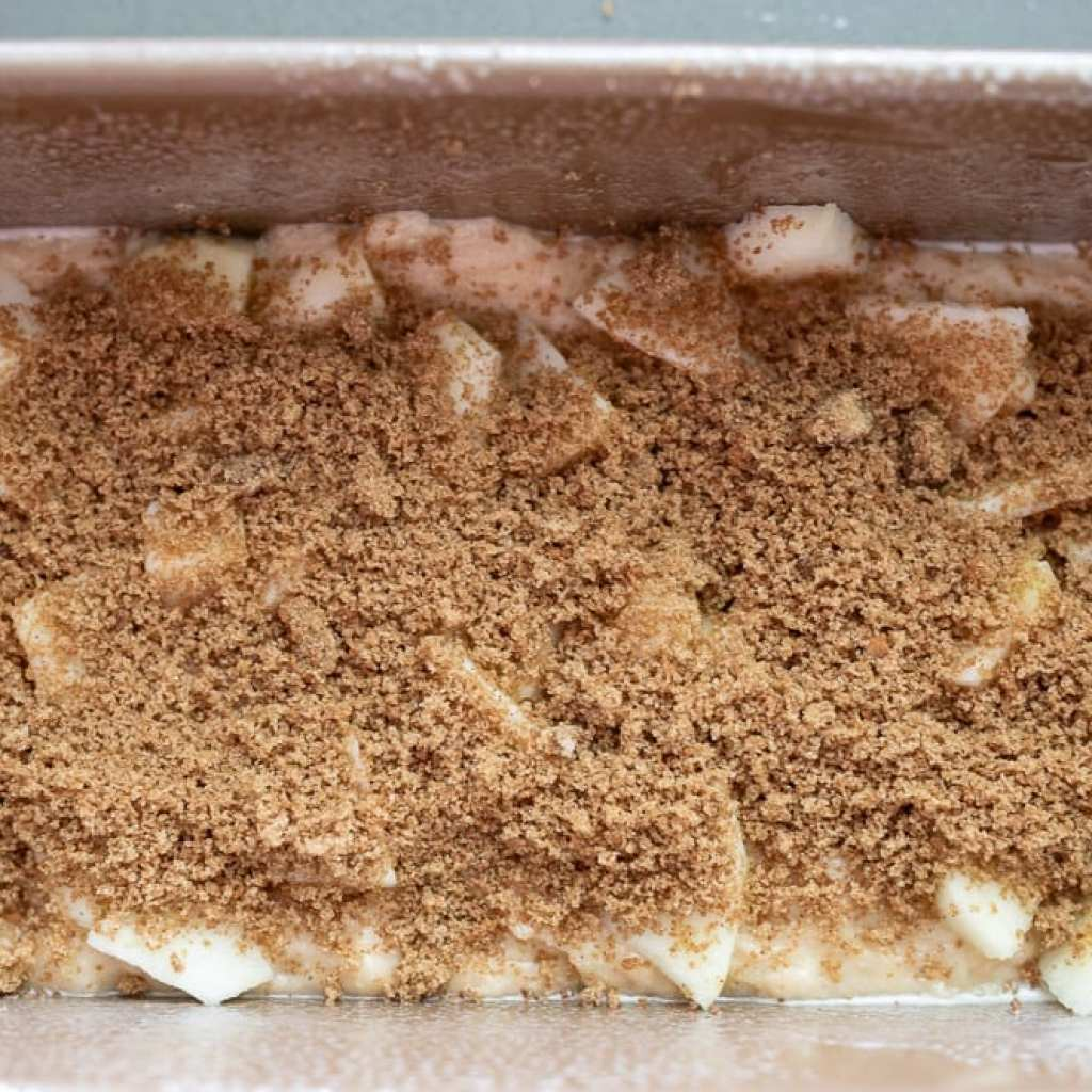 brown sugar mix on apples on loaf pan for layered apple loaf