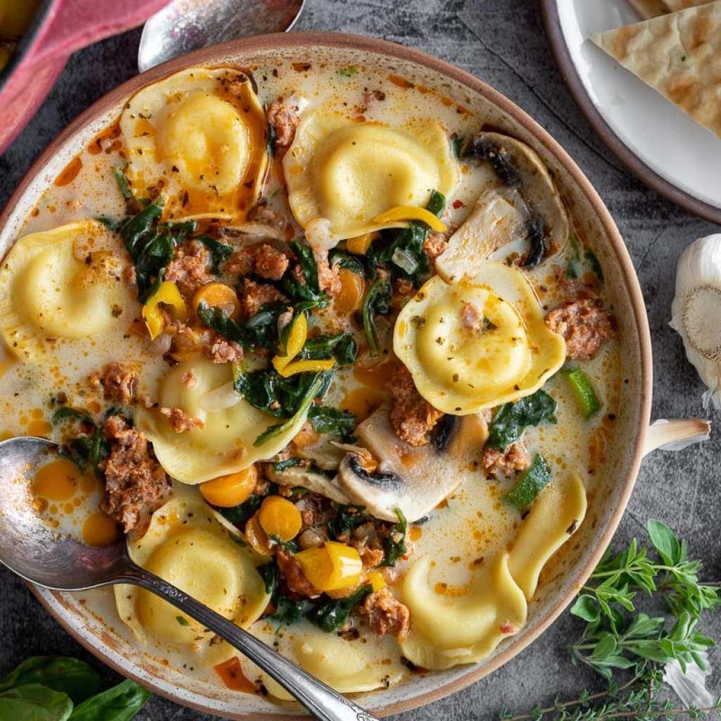 Cozy Sausage and Ravioli Soup in ceramic bowl
