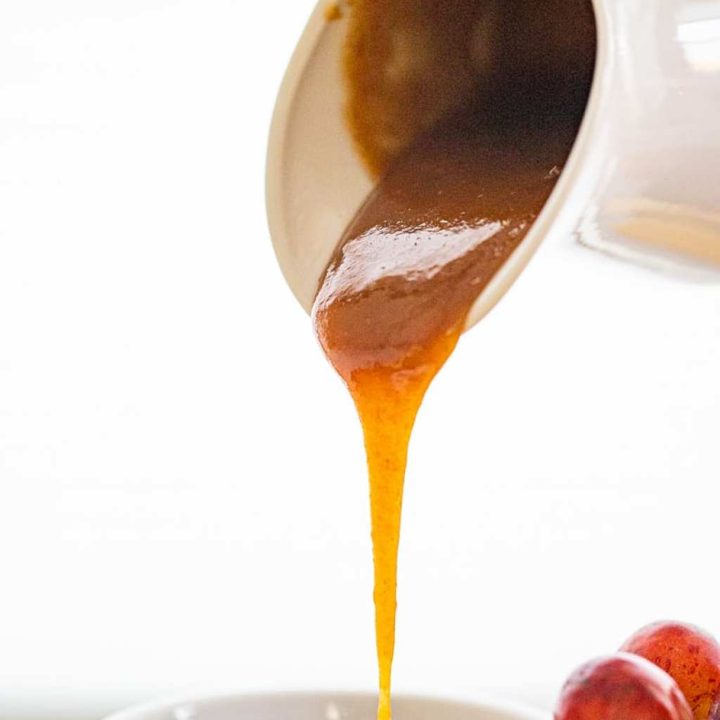pouring maple caramel into small white ramekin
