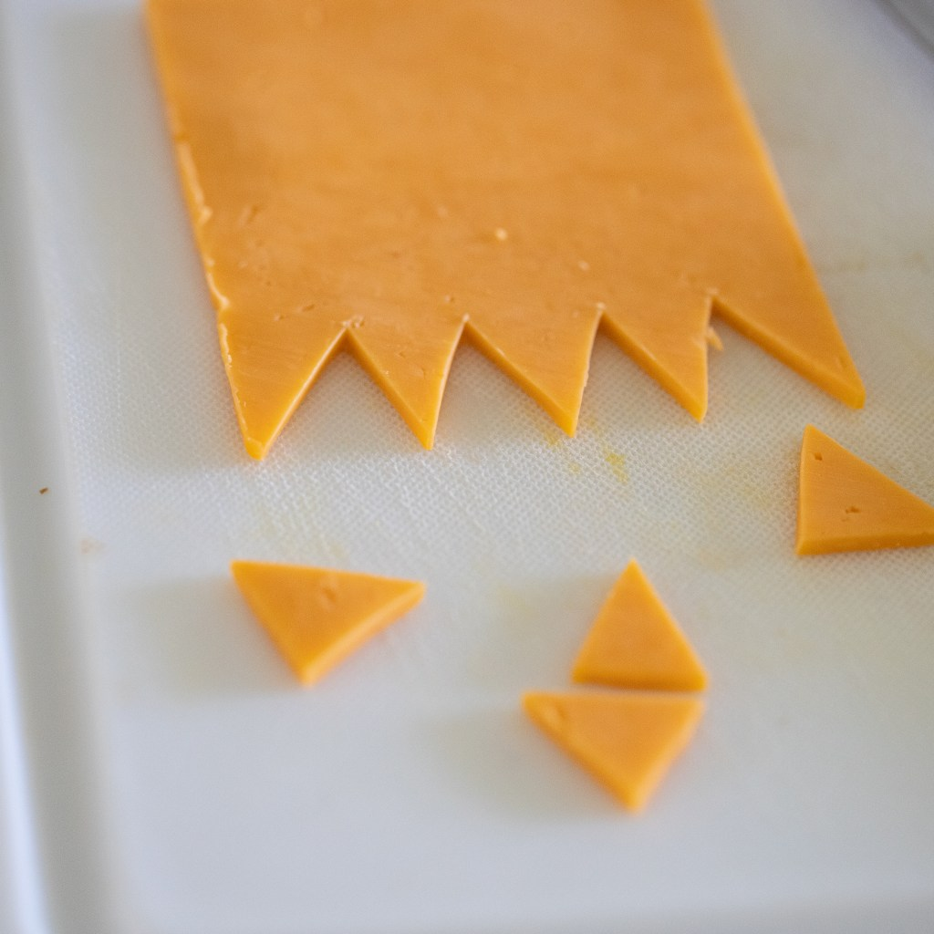 cutting teeth on cheese for monster bugers
