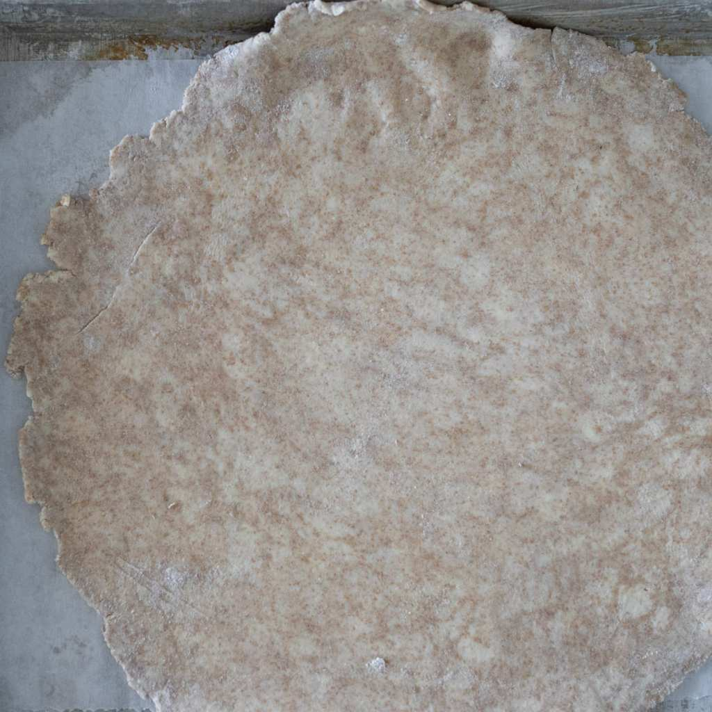 whole wheat crust rolled out for savory galette