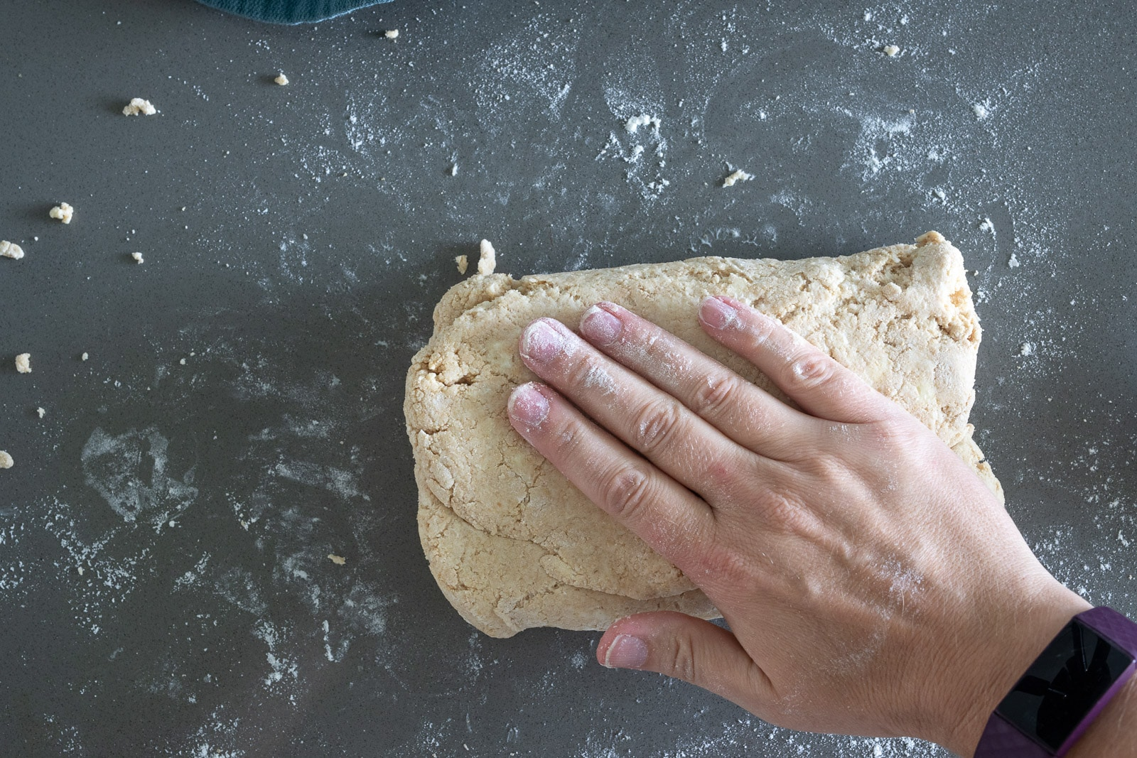 woman folding biscuits for 100% whole wheat biscuit dough.