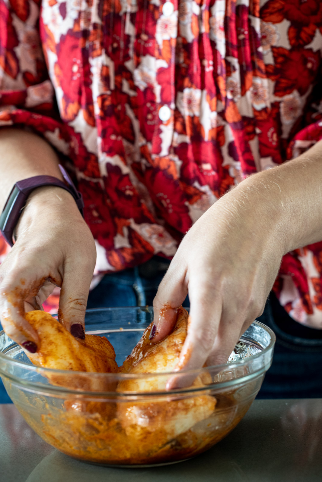 Woman mixing cod filets in a marinade.
