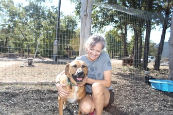 """Adette Quitana and rescued dog, she named Maybelline because of her """"natural eyeliner""""."""
