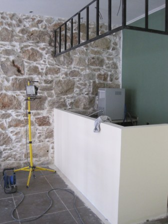 Bar in progress. The ironwork man put everything in the wrong place and had to do it all over again.