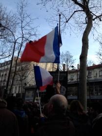 Flag-waving at the rally following the Charlie Hebdo attacks