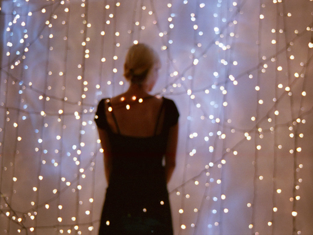 Woman bathed in lights