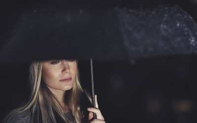 woman with umbrella after breakup