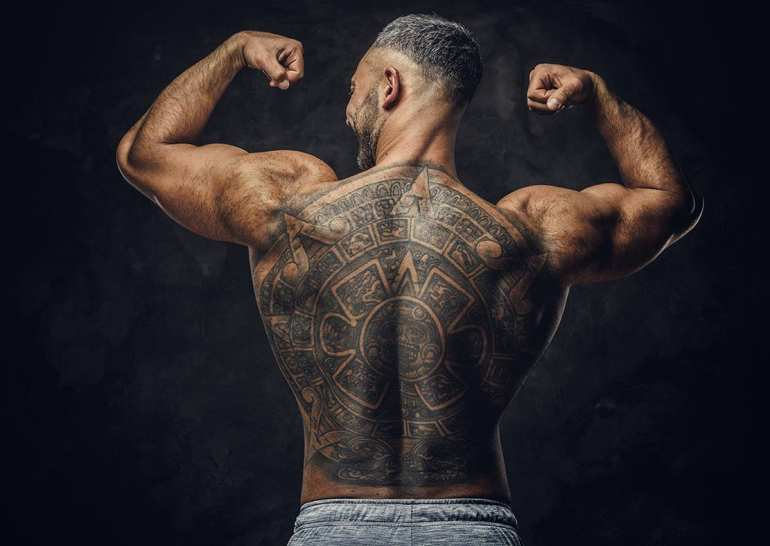 Strong man with tattoo