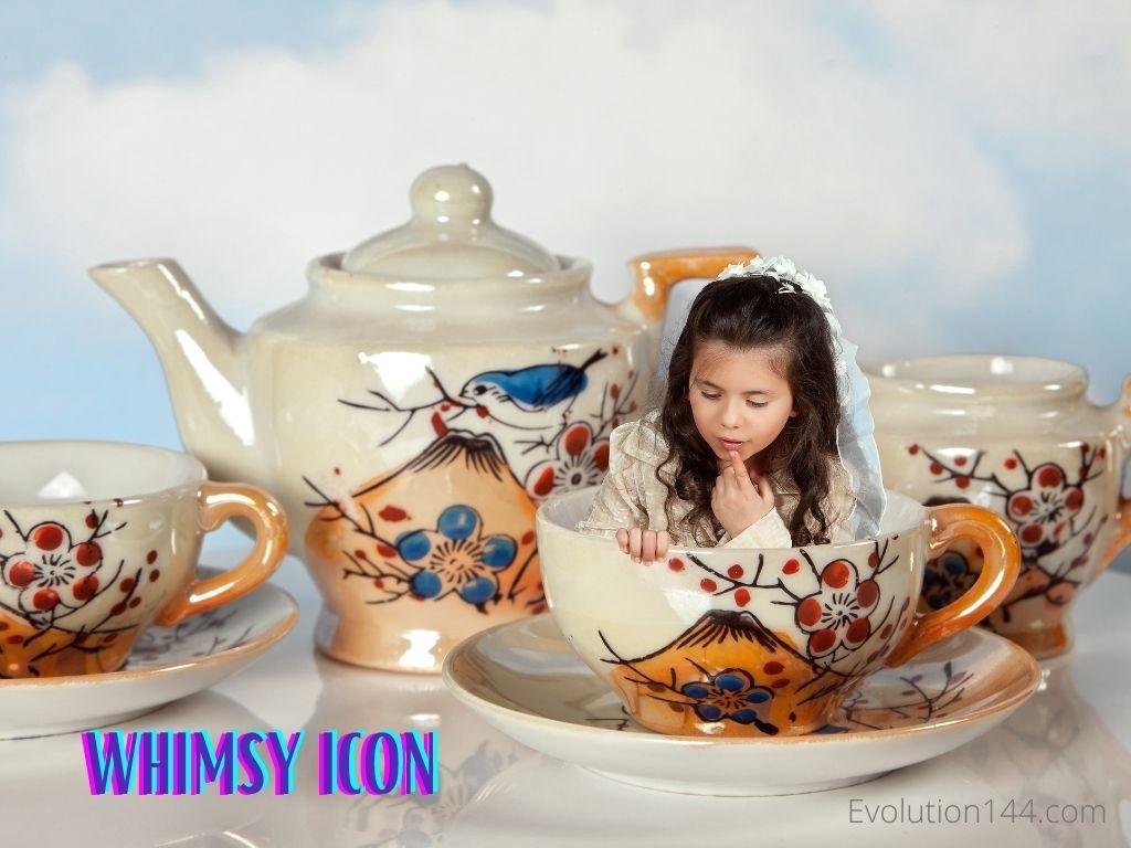 girl sitting in teacup