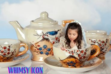 girl sitting in teacup