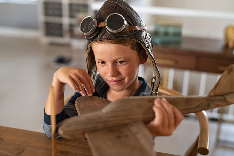 boy with toy airplane
