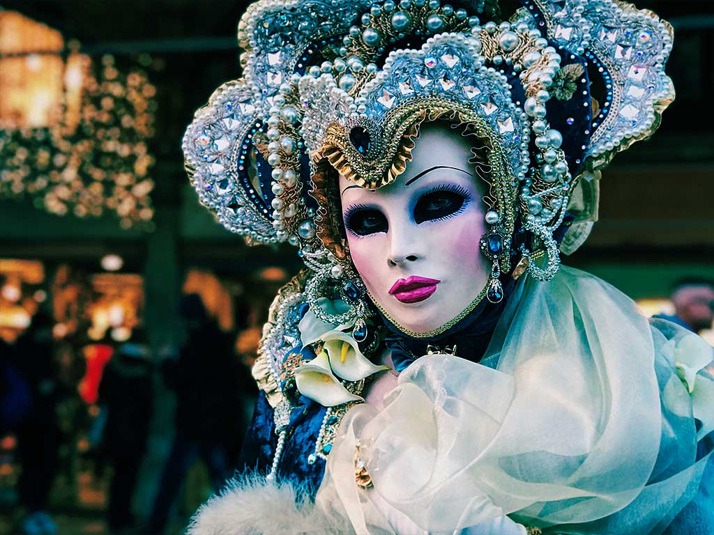 woman in Mardi Gras costume