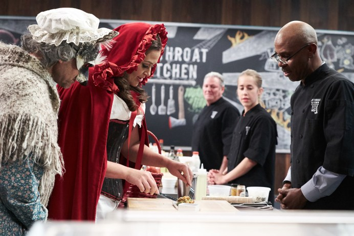 Host Alton Brown and Judge Antonia Lofaso judging Chef Ian Russell's Round 2 dish, Deconstructed Spider Roll, as seen on Food Network's Cutthroat Kitchen, Season 14.