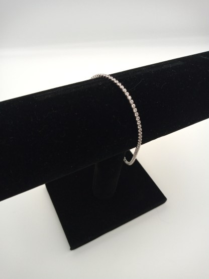 925 silver adjustable cz bracelet on jewellery stand
