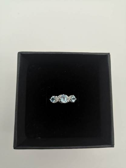 925 silver blue topaz and diamond ring in eco friendly jewellery case