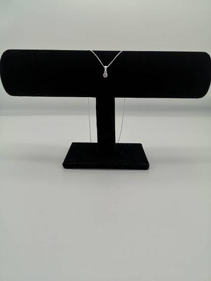 925 silver pink cz birthstone pendant on jewellery stand