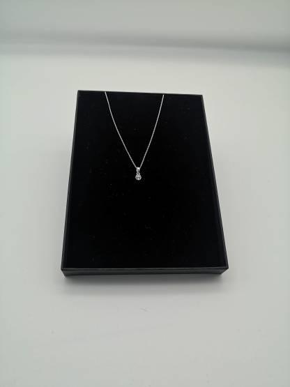 925 silver white cz birthstone pendant in eco friendly jewellery case