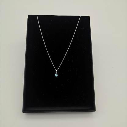 925 silver light blue cz birthstone pendant in eco friendly jewellery box