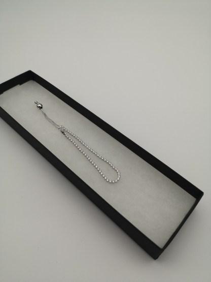 silver adjustable cz bracelet in box
