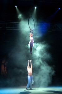 Acrobat performing on aerial ring - Argolla show