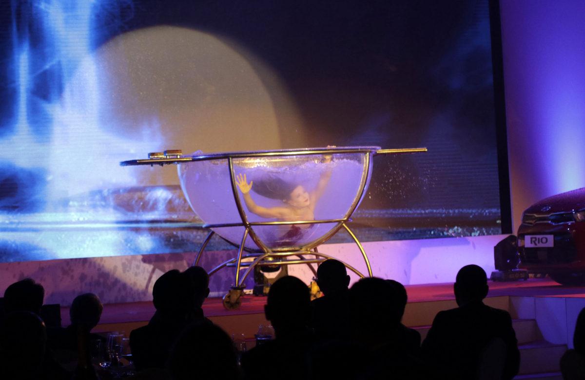 transparent water bowl acrobatic show - corporate entertainment - Kia Car Launch