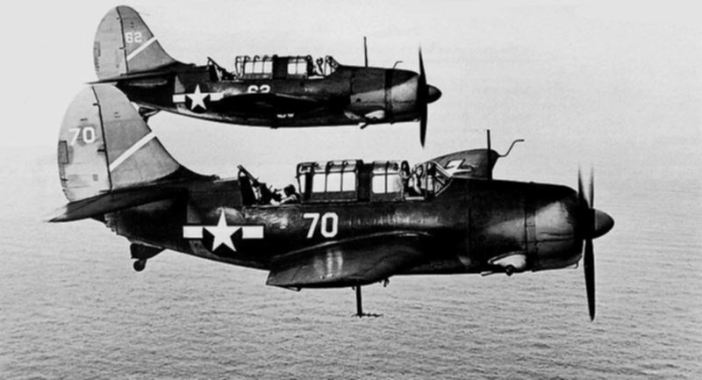 Two Curtiss SB2C Helldiver dive bombers in flight in 1943.