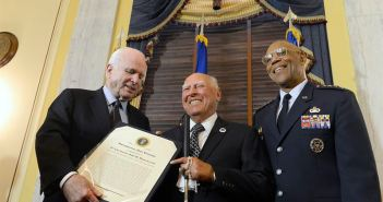 Sen. John McCain and Air Force Vice Chief of Staff Gen. Larry O. Spencer congratulate 2nd Lt. John Pedevillano, a WWII Army Air Corps B-17 bombardier, during a ceremony in his honor, in Washington, D.C., July 7, 2015. McCain and Spencer presented Pedevillano with the Presidential Unit Citation with one oak leaf cluster. He is the last survivor of his WWII unit. (Credits: U.S. Air Force photo/ Scott M. Ash)