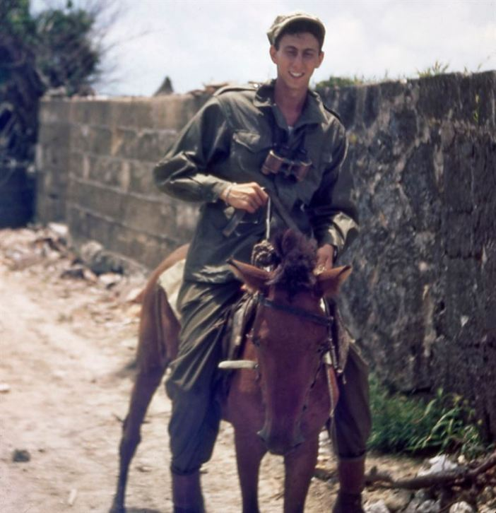 Jerry's legs are longer than the horse's. Note the binoculars; they were taken by the Japanese from MacArthur's American soldiers in Bataan when they surrenderd. Then, the binoculars returned to American hands when the Jap soldier from Bataan was killed in the Philippines. Jerry bought them there from another American soldier. American GI's were careful to wait until Jap soldiers were right upon their foxhole before opeing fire. This assured that, come the next morning, the soldier in the foxhole would have first crack at any good souvenirs on the Jap's body.