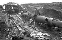 Canadian and American soldiers examining abandoned Japanese submarines on Kiska, Aleutian Islands, September 1, 1943. (Credits: Library and Archives Canada)