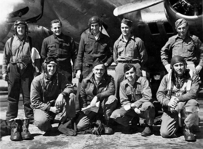 "Newman's Crew, 603rd Squadron on 15 August 1944. Probably in the background is probably B-17 43-37982 N7-K ""Bebe"". Back Row (viewer's left to right): S/Sgt. Norman Bergsma, Radio .. S/Sgt. Leroy Kucharski, Gunner .. T/Sgt. Cornelius Harrington, Engineer .. S/Sgt. Arnold Money, Gunner .. S/Sgt. Steve Kurcharski, Gunner .. Front Row (viewer's left to right): 2nd Lt. William D. Whitaker, Bombardier .. 1st Lt. Herbert H. Newman, Pilot .. 2nd Lt. William Frankhouser, Navigator .. 2nd Lt. Paul Deininger, Co-Pilot"