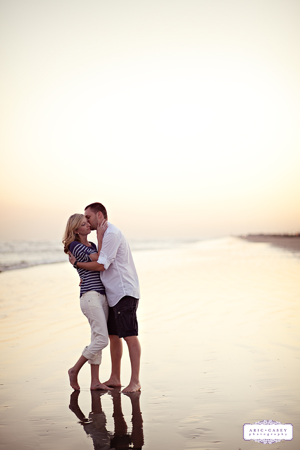 romantic engagement images on the beach at sunset galveston texas by aric and casey photography