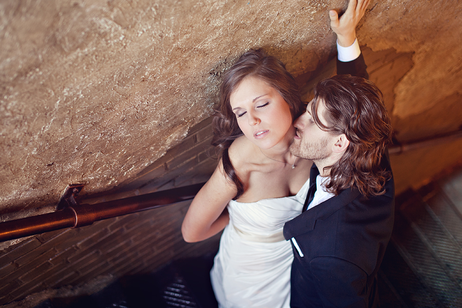 Romantic Steamy Bride and groom portraits of Caitlin Vaughn and Ryan Thurman at McPherson Wine Cellars by Aric and Casey Photography in Lubbock Texas