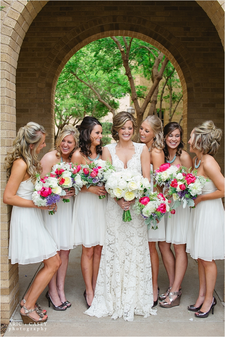 white bridesmaid dresses with colorful flowers