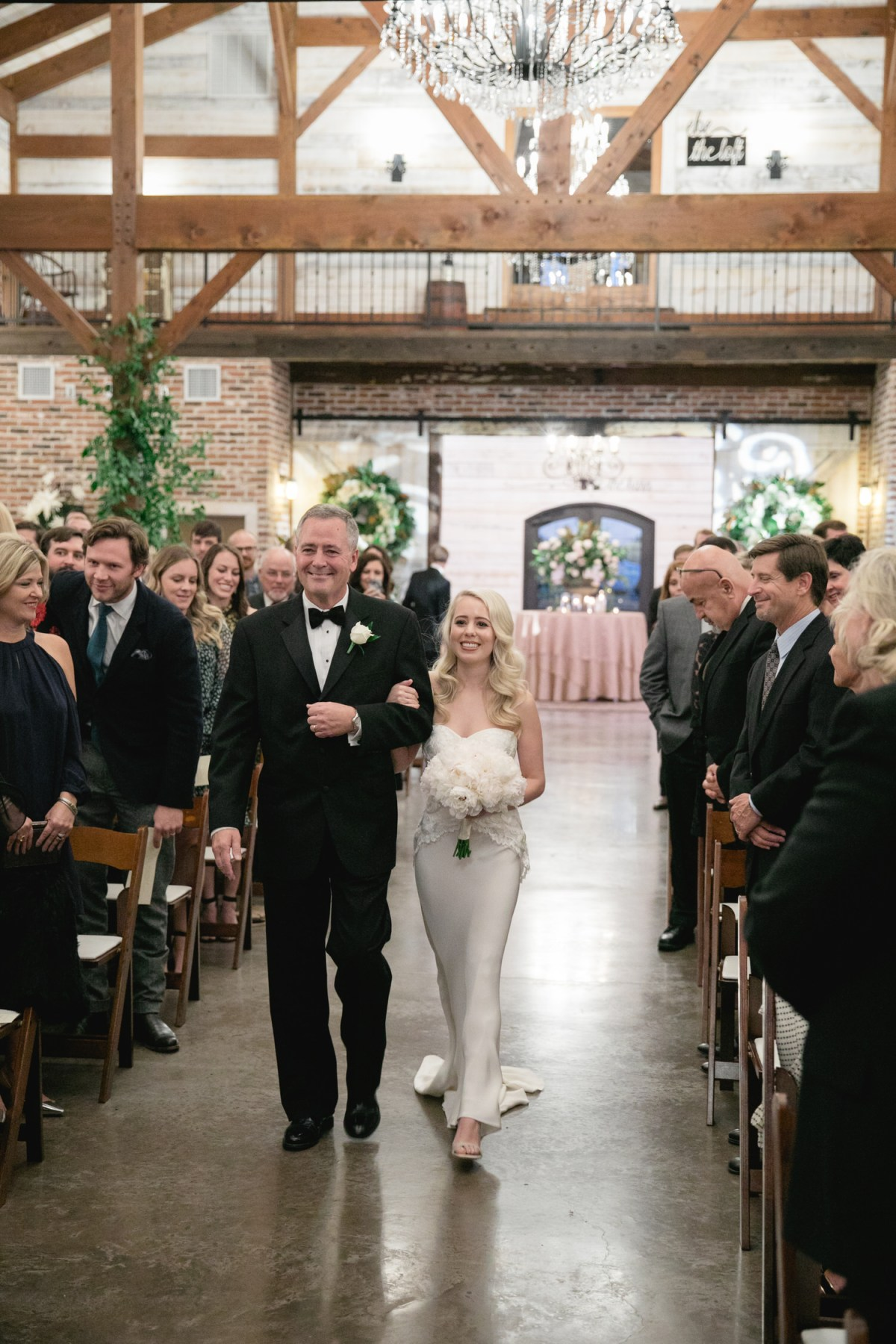 bride walks down aisle at eberley brooks events