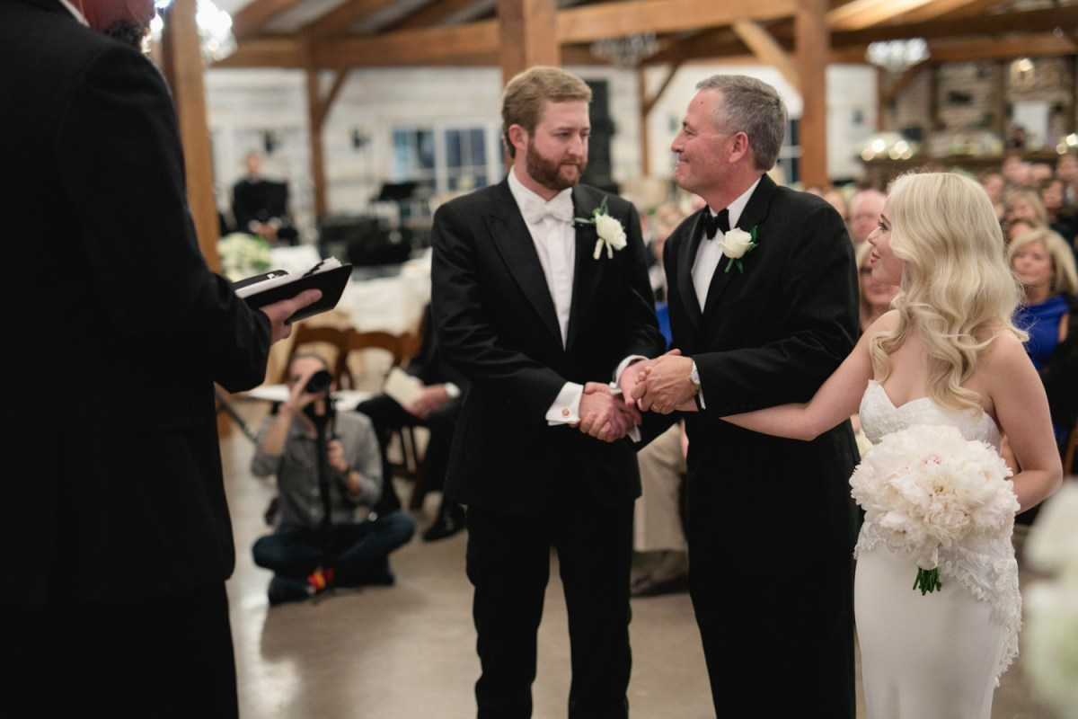 father of bride gives her away