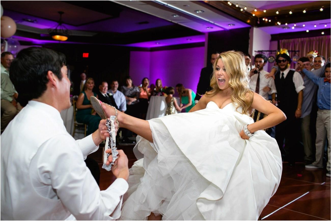 groom pulls garter