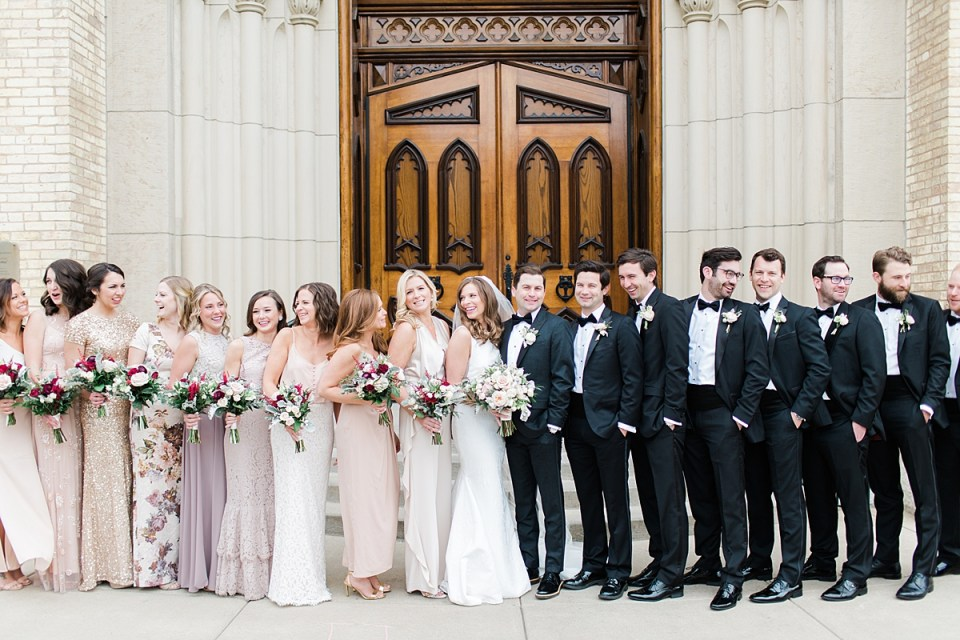 Arielle Peters Photography | Wedding party outside cathedral doors on wedding day at the Basilica of the Sacred Heart in Notre Dame, Indiana.