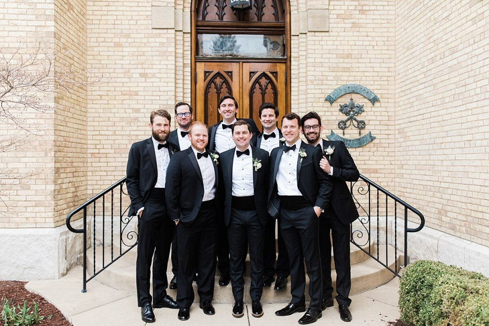 Arielle Peters Photography | Groom and groomsmen in front of cathedral doors on wedding day at the Basilica of the Sacred Heart in Notre Dame, Indiana.