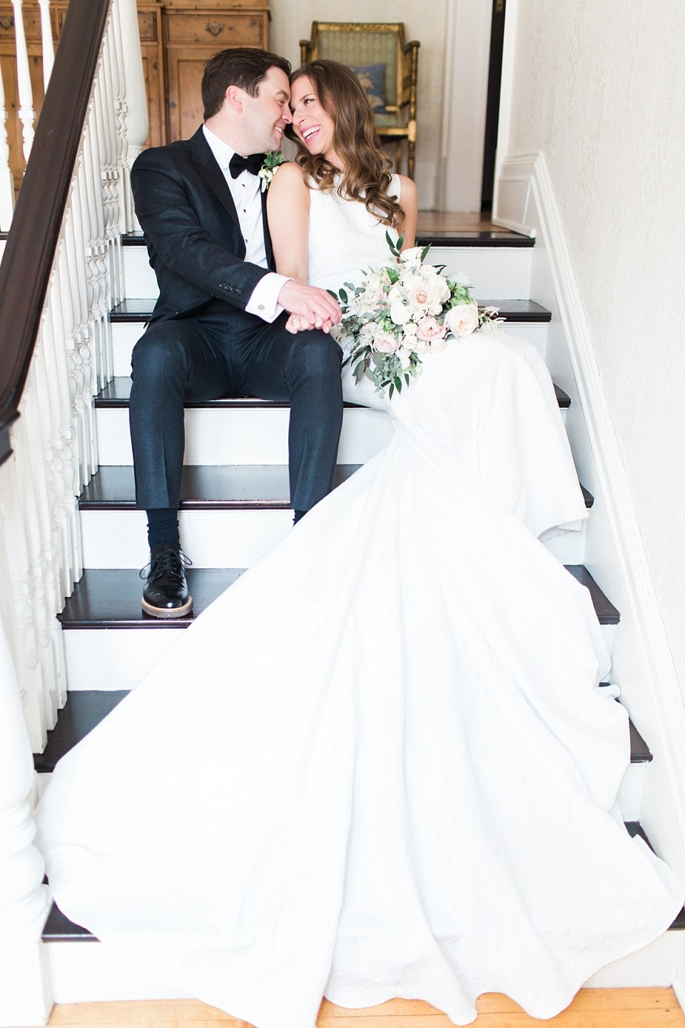 Arielle Peters Photography | Bride and groom sitting inside on stairs on wedding day at the Basilica of the Sacred Heart in Notre Dame, Indiana.