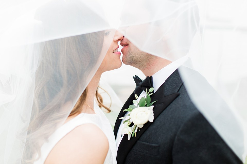 Arielle Peters Photography | Bride and groom kissing under veil on wedding day at St. Joseph's Farm in Granger, Indiana.