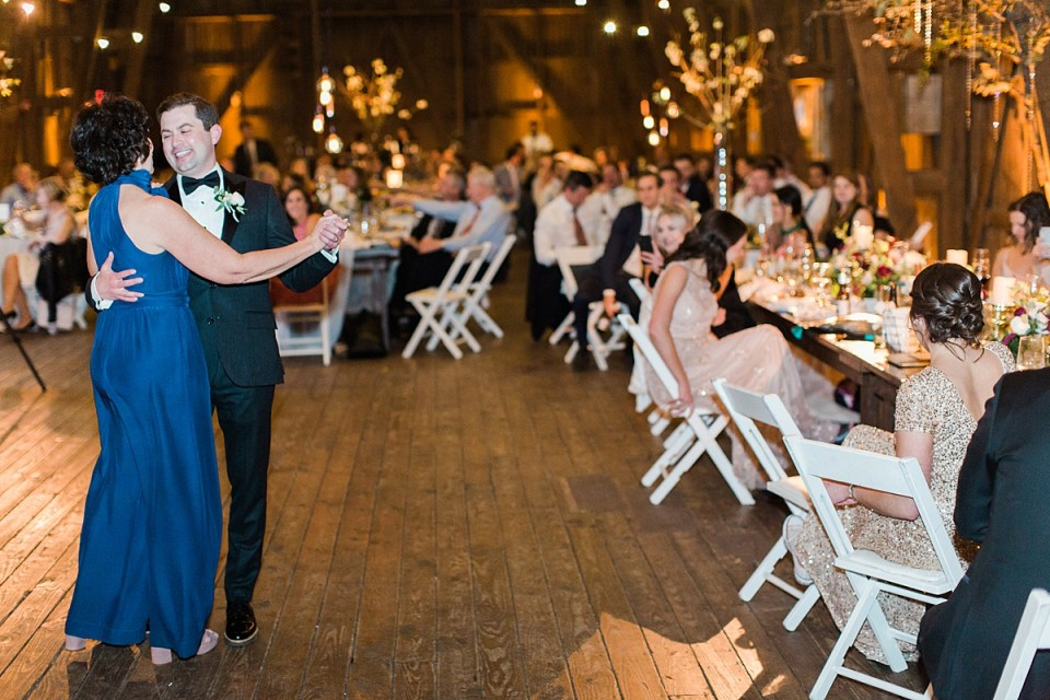 Arielle Peters Photography | Mother of groom and groom sharing a dance at wedding reception on wedding day at St. Joseph's Farm in Granger, Indiana.
