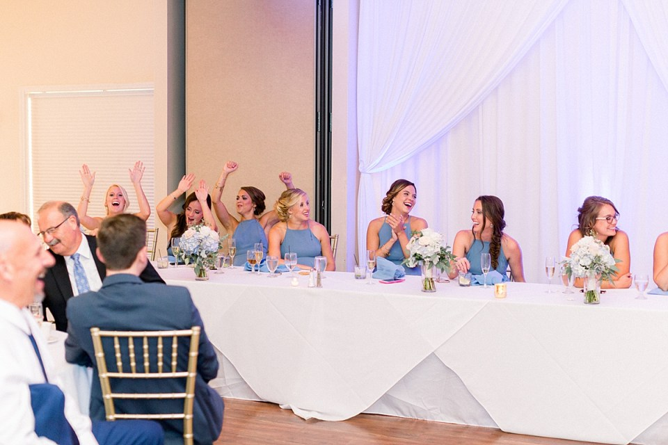 Arielle Peters Photography | Bridesmaids laughing at wedding reception at The Blue Heron at Blackthorn in South Bend, Indiana on wedding day.
