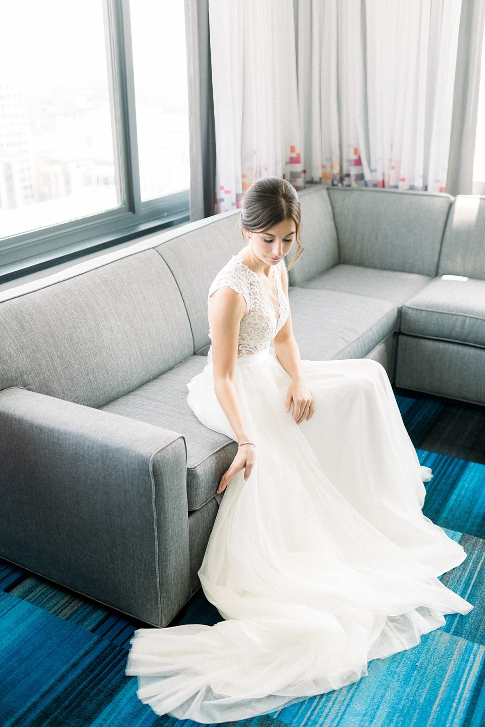 Arielle Peters Photography | Bride sitting in her gown at The Blue Heron at Blackthorn in South Bend, Indiana on wedding day.