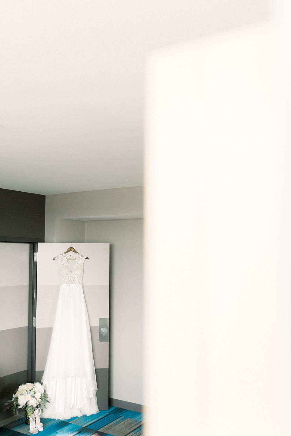 Arielle Peters Photography | Wedding gown hanging at The Blue Heron at Blackthorn in South Bend, Indiana on wedding day.