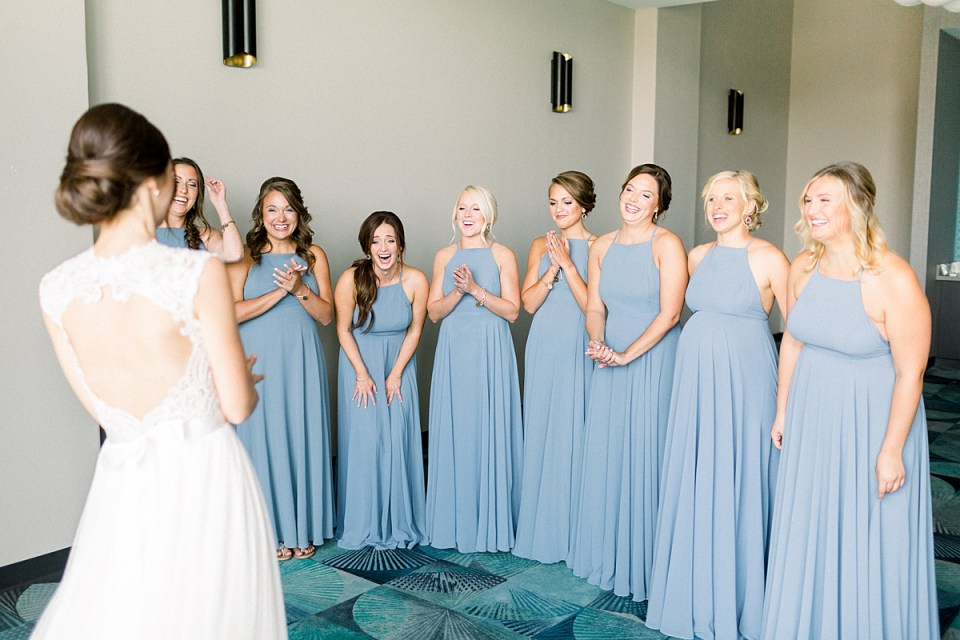 Arielle Peters Photography | Bridesmaids having first reveal of the bride on wedding day at The Blue Heron at Blackthorn in South Bend, Indiana on wedding day.